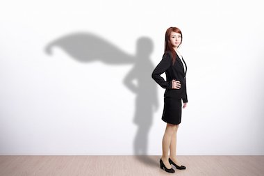 office worker standing by wall and shadow in the wall has a cape like a superhero