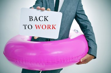 Man with a rubber ring around him, holding a back to work sign