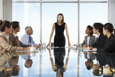 woman standing at boardroom table