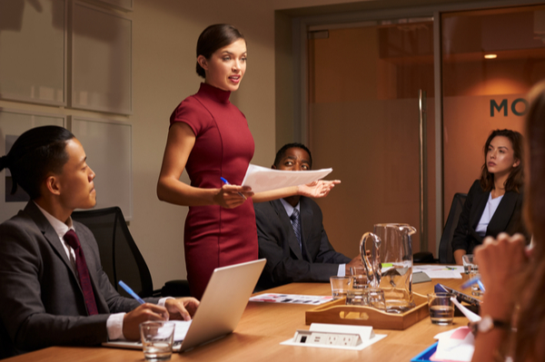 Woman speaking in front of her colleagues in the office