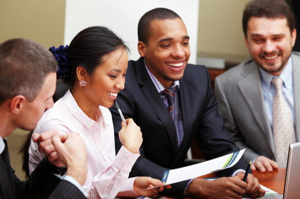Group of people in a meeting, laughing
