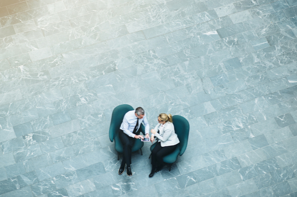 Two people having a meeting out in the open
