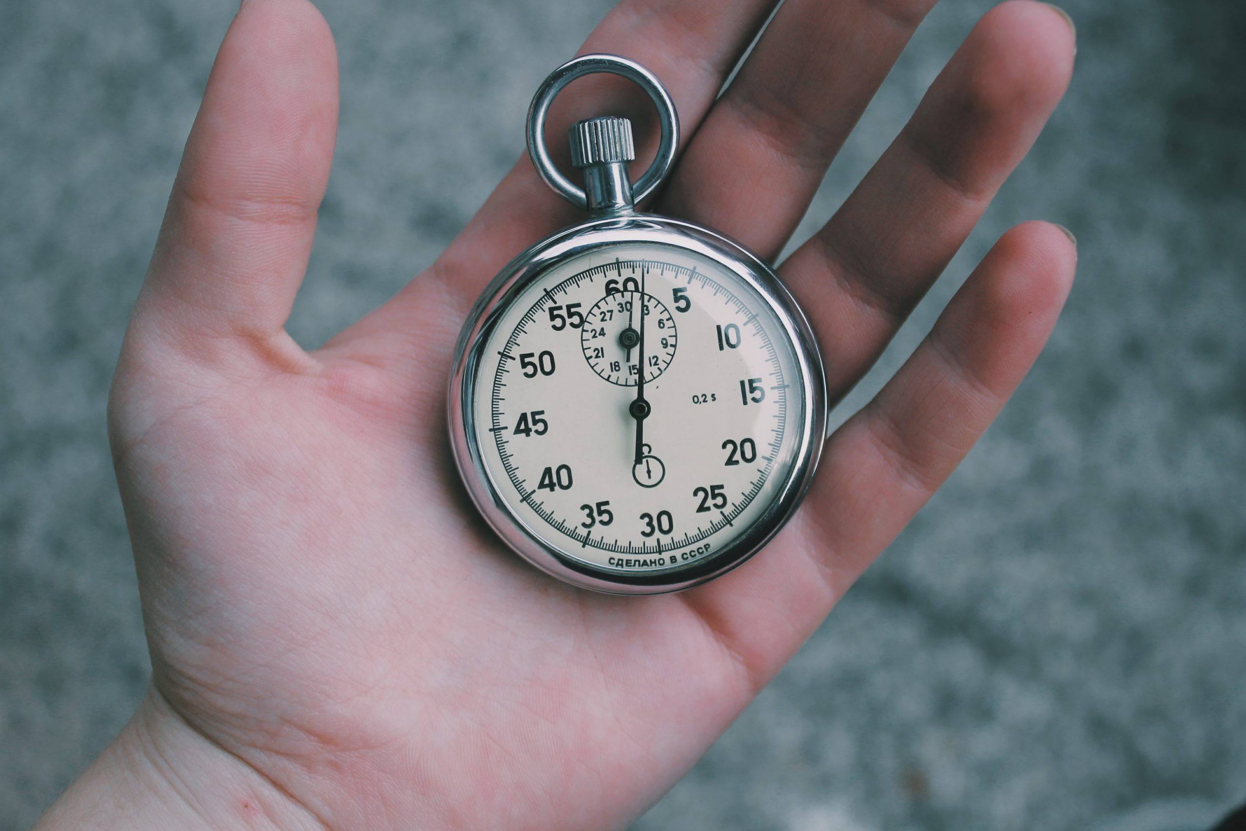 A pocket watch in the palm of someone's hand