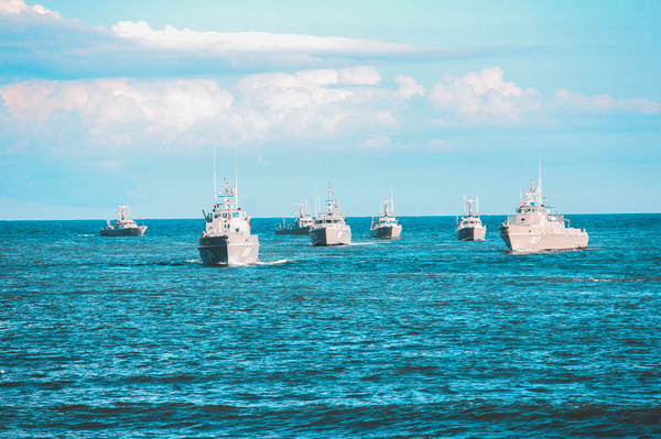 a group of royal navy ships in the ocean