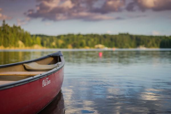 a wooden boat on the lake