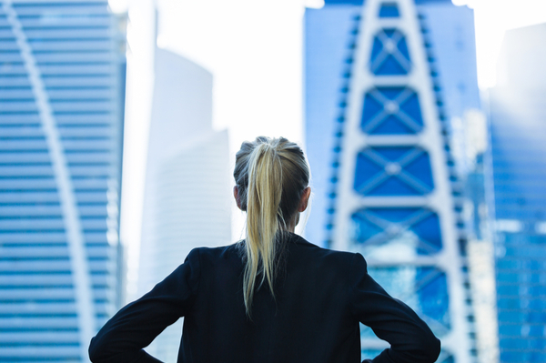 woman is looking at skyscrapers