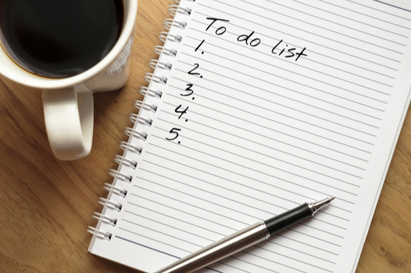 Notepad with to do list written on the first page