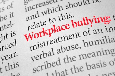 Dictionary with the word workplace bullying highlighted in red