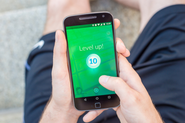 "Smartphone screen with ""Level Up"" text on it"