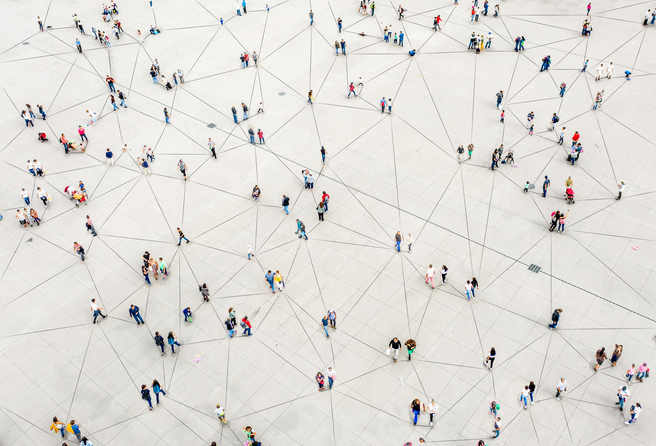 Aerial view of crowd connected by lines representing CMI community