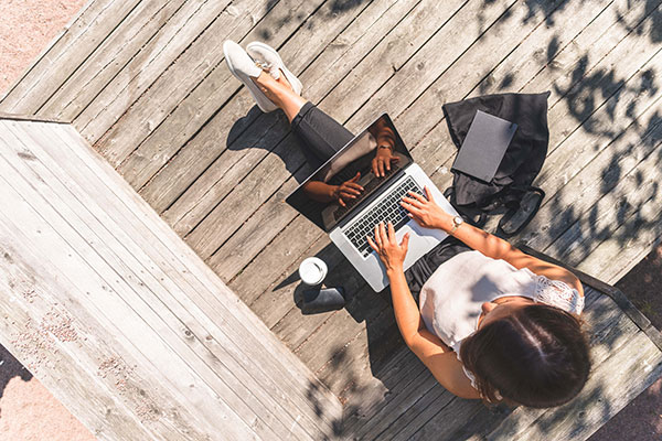 woman-sitting-in-sun-working