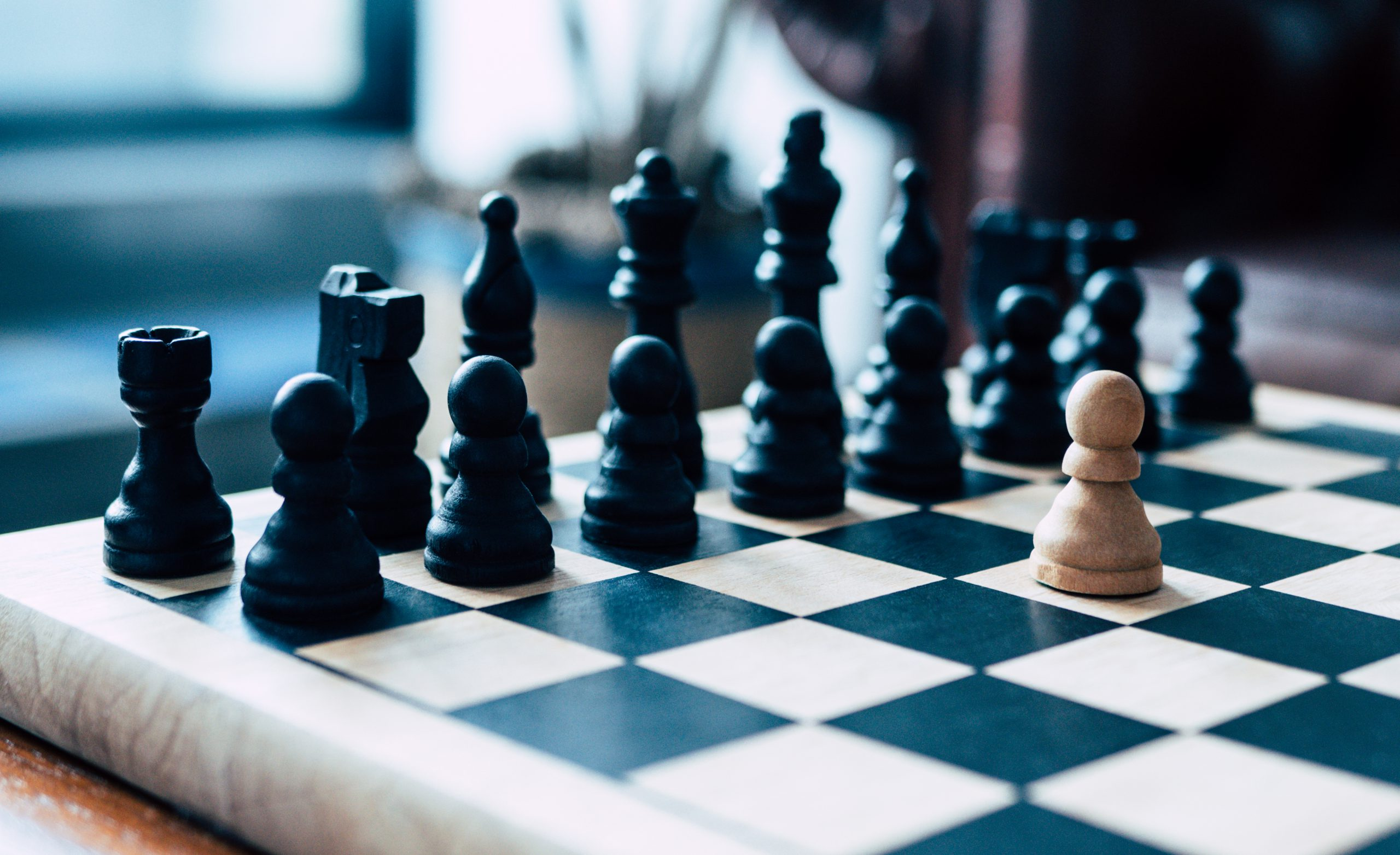 single pawn against full set of chess pieces