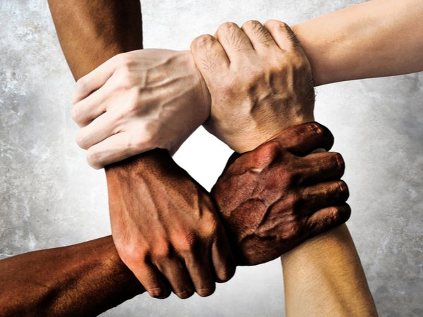 Hands of different ethnicities in a square