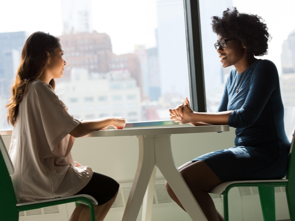 Two women having a conversation at work