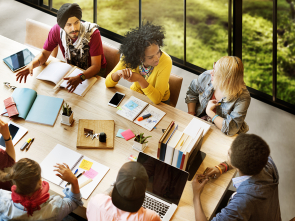 Inclusive workplace and diverse team having meeting
