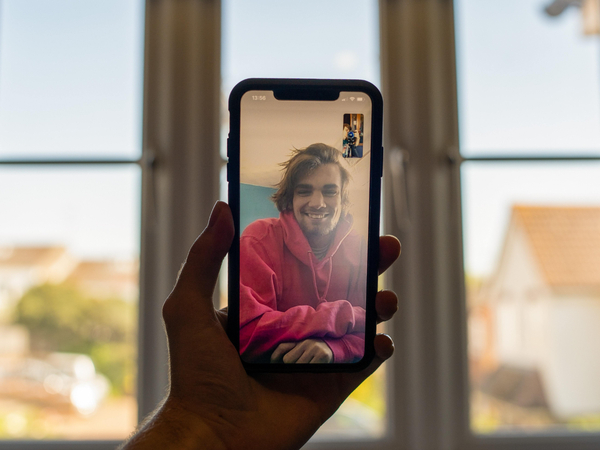 Person on a phone screen's video call