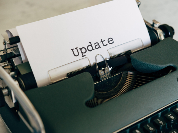 """Typewriter with paper that says: """"update"""""""