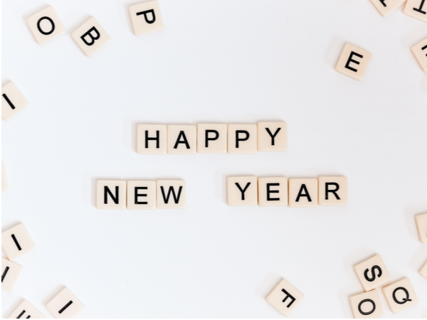 Scrabble tiles spelling out 'Happy New Year'