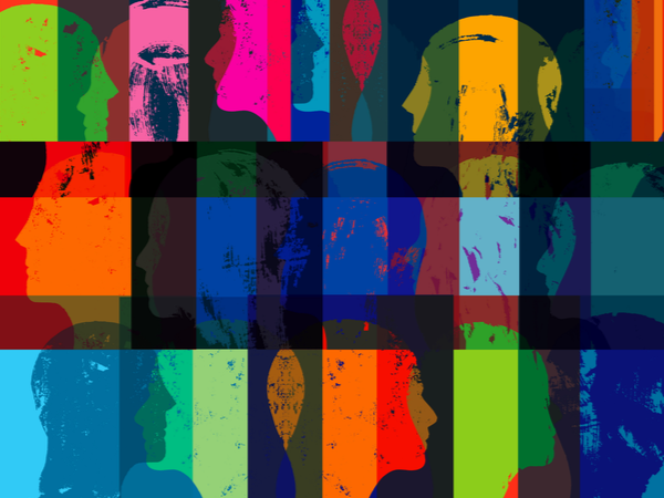 Abstract, overlapping silhouettes of faces in many colours