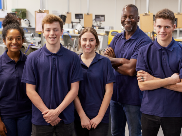 Group of apprentices smiling at the camera