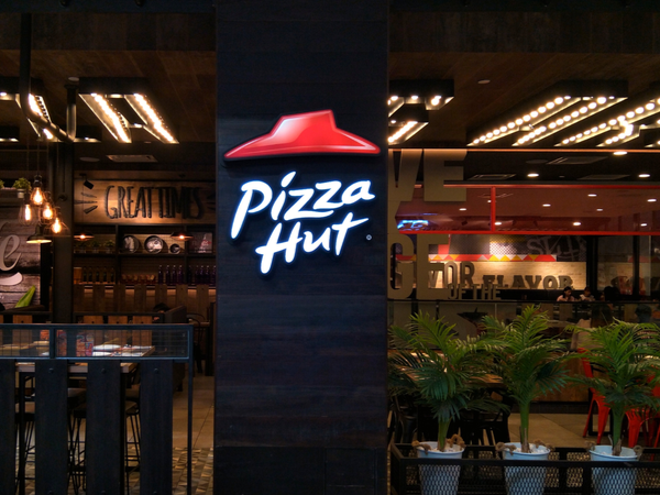 Pizza Hut logo on a restaurant front