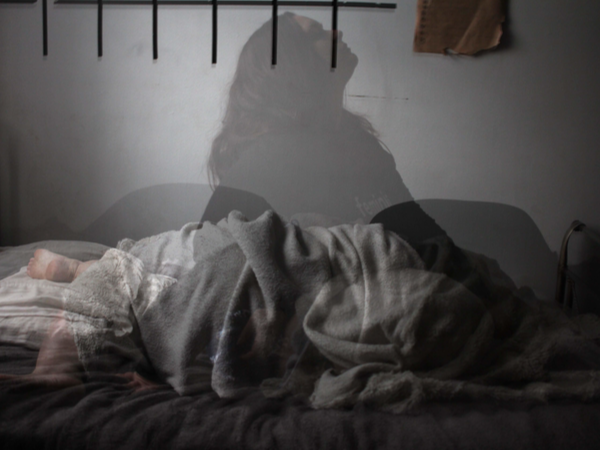 Overlay of a person lying in bed and a person sitting up in bed