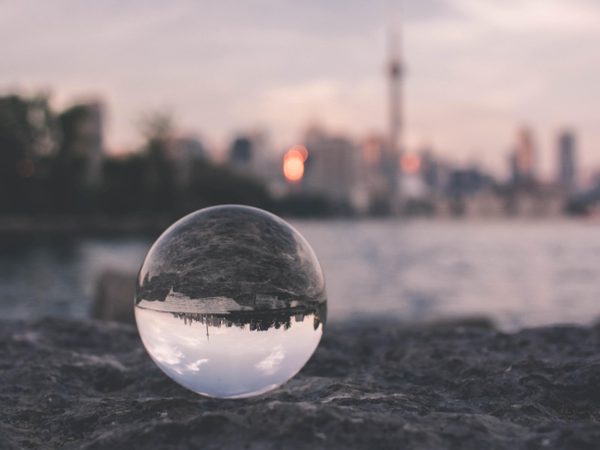 Glass ball in front of city skyline - the ball has inverted the skyline so it's upside down