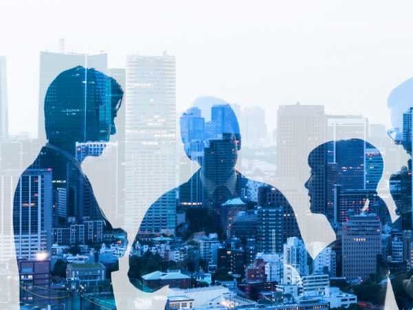 Double exposure of group of business people and cityscape