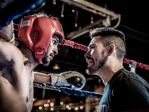 Coach speaking to boxer in the right
