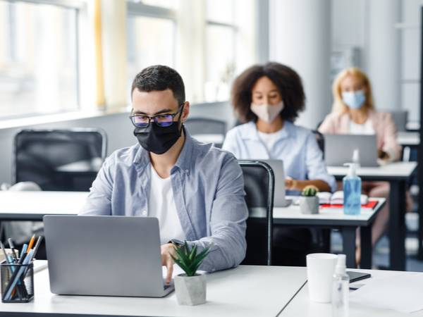 People in their workplace in face masks