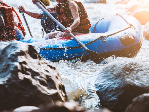 People in a boat, white water rafting