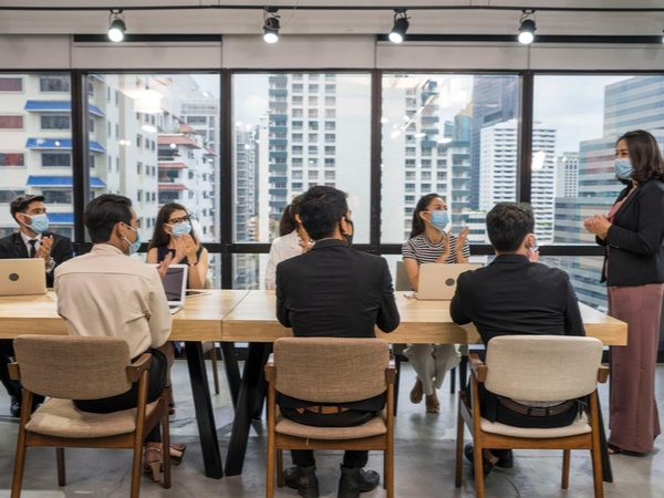 Employees in a meeting wearing face masks
