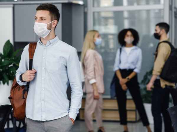 People with face masks on in the workplace