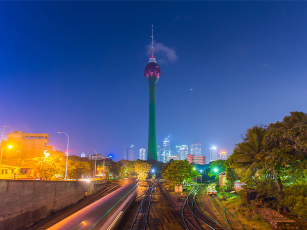 The lotus tower in front of the nighttime Colombo skyline in Sri Lanka