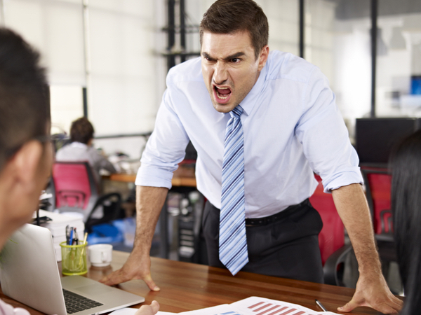 Angry manager shouting at employees