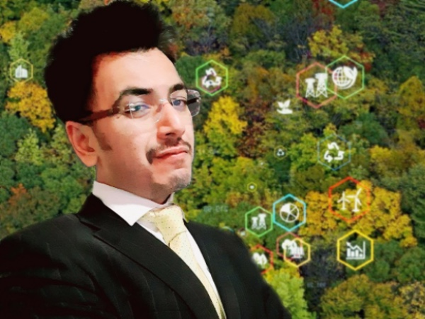 Punit Shah surrounded by trees and symbols of sustainability