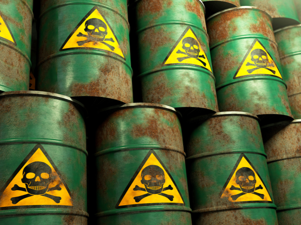 A stack of green barrels with a skull and crossbones on them