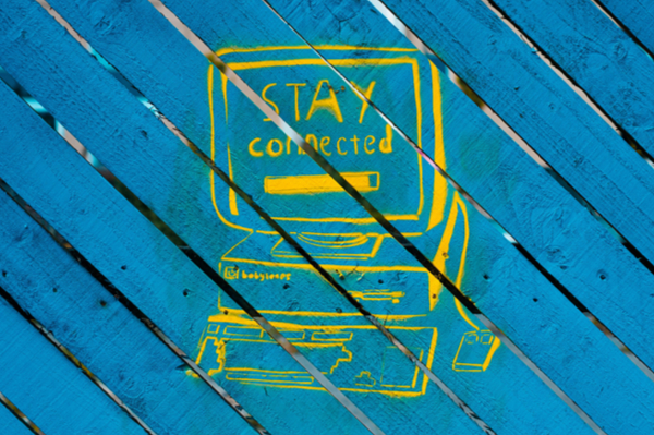 Graffiti of computer with 'Stay Connected' written onscreen