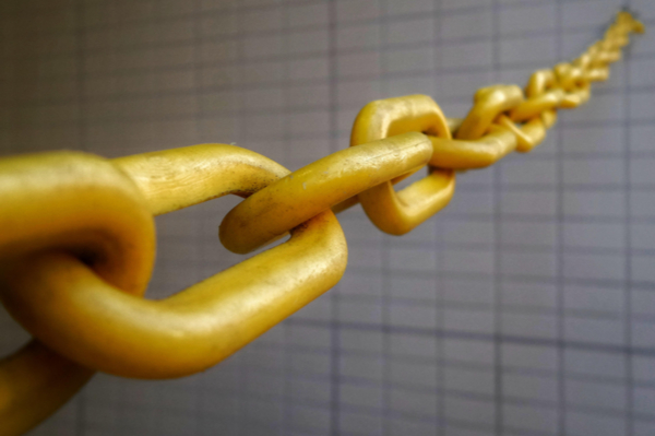 Yellow chain against tiled background