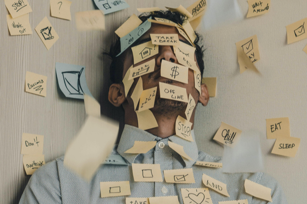 Man covered in sticky notes